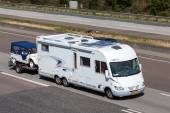 Frankia Luxury Class mobile home with a trailer — Stock Photo