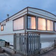 Mobile home on a trailer park at dusk — Stock Photo #80578692
