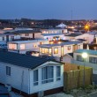Mobile homes on a trailer park at dusk — Stock Photo #80578716