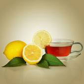 Tea cup with lemon and mint leaf — Stock Photo