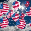 Many balloons with usa flag on sky — Stock Photo #74114641
