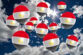 Many balloons with egypt flag on sky — 图库照片