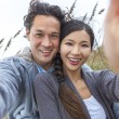Asian Couple at Beach Taking Selfie Photograph — Stock Photo #53972937
