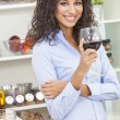 Woman Drinking Red Wine in Home Kitchen — Stock Photo #53974123