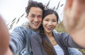 Asian Couple at Beach Taking Selfie Photograph — Stock Photo