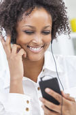 African American Girl Listening to MP3 Player Headphones — Stock Photo