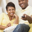 Couple in their thirties watching television — Stock Photo #58621145