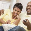 Couple in their thirties watching television — Stock Photo #58621153