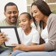 Family using tablet computer together — Stock Photo #58621207