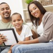 Family using tablet computer together — Stock Photo #58621231
