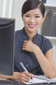 Businesswoman at the computer — Stock Photo