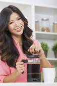 Woman making cup of coffee with cafetiere — Stock Photo