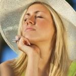 Beautiful woman wearing sun hat — Stock Photo #62972599