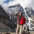 Man Looking at Moraine Lake — Stock Photo #62972691