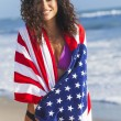 Woman wrapped in American flag — Stock Photo #62972723