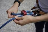 Close up of Woman's hand in belaying activities — Stock Photo
