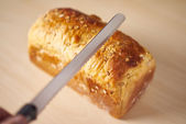 Preparing to slice a wholemeal bread — Stock Photo