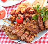 Grilled meat - delicious meal (specialty grilled) — Stock Photo