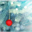 Red bauble on Christmas tree (xmas ball) — Stock Photo #55759095