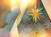 Christmas star on Christmas tree with Christmas light — ストック写真