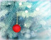 Red bauble on Christmas tree (xmas ball) — 图库照片