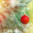 Red bauble on Christmas tree (xmas ball) outdoors — Stock Photo #56087261