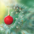 Red bauble on Christmas tree (xmas ball, christmas ornament) — Stock Photo #58132465