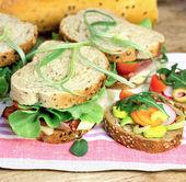 Vegetarian sandwiches and ham sandwiches — Stock Photo