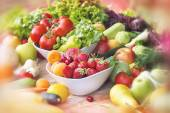 Fresh organic fruits and vegetables on table — Stock Photo