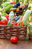 Fresh organic vegetables in wicker basket — Stock Photo
