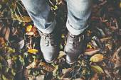 Vintage boots on fall foliage — Stock Photo