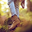 Autumn cowboy style. Cowboy boots in the woods — Stock Photo #53854715