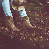Autumn cowboy style. Cowboy boots in the woods — Stock Photo