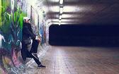 Portrait fashionable girl blonde fall urban trend style on graffiti wall — Stock Photo