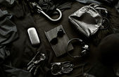 Set of trendy stylish black accessories and clothes on a black background — Foto Stock