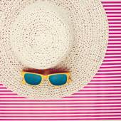 Plastic sunglasses on a laced summer hat for women — Stock Photo