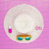 Summer fashion ensemble on a striped background — Stock Photo