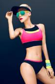 Slim athletic fitness blonde on a black background in the fashio — Стоковое фото