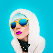 Positive girl on bright blue background. winter Style — Stok fotoğraf