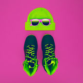 Stylish fashion sport accessories: sneakers, sunglasses, hat on  — Stock Photo