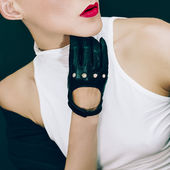Sexy Model on black background in trendy gloves and jacket.  ?utumn fashion style — Stock Photo