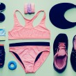 Lady fitness style. Sports Accessory Set on green background — Stock Photo #59744505