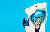 Crazy party girl in hoodie bear on a blue background. positives — Stock Photo