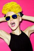 Disco punk fashion style emotional dancing girl — Stock Photo