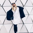 Glamorous blonde standing at the wall. Urban fashion black and w — Stock Photo #61810255