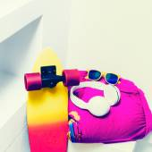 Extreme sports accessories. Skateboard and bright fashionable cl — Stock Photo