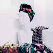 Fashion Mannequin in white interior. Choice scarves. Stylish wom — Stock Photo