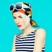 Blonde in fashionable summer accessory. Headscarf. — Stock Photo