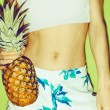 Summer girl with pineapple. Tropical style, fashion, summer clot — Stock Photo #66809335