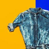 Stylish denim shirt on bright background — Stock Photo